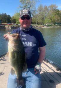 Owner Fish Sense Lures witha big largemouth on the Binsky
